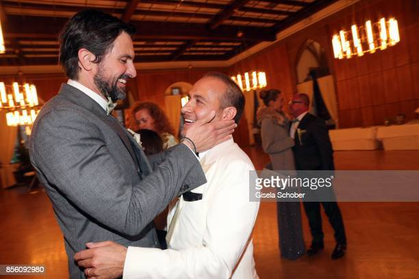 Tom Beck congrats Bridegroom Erdogan Atalay during the church wedding of Erdogan Atalay and Katja Ohneck at Heidelberg Castle on September 30 2017 in...