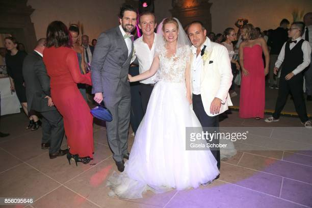 Tom Beck Daniel Roesner Katja Ohneck and Erdogan Atalay during their church wedding at Heidelberg Castle on September 30 2017 in Heidelberg Germany