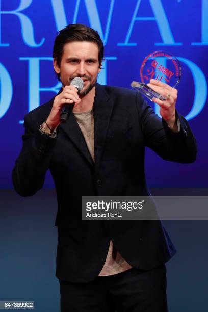 Tom Beck poses with his award during the Glammy Award 2017 on March 2, 2017 in Munich, Germany.