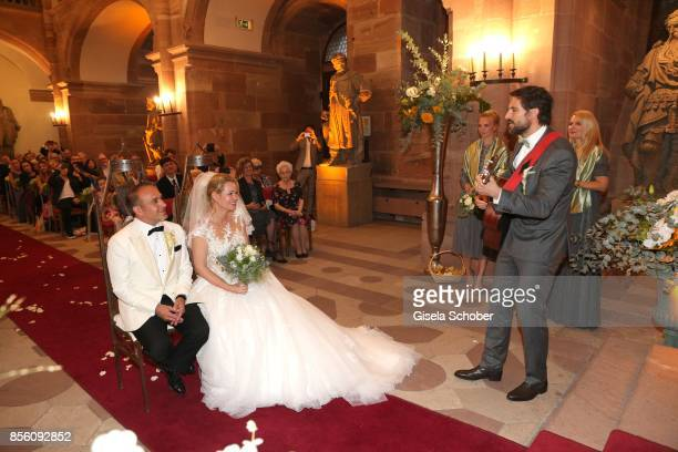 Tom Beck sings for bridegroom Erdogan Atalay and his wife Katja Ohneck during their church wedding at Heidelberg Castle on September 30 2017 in...