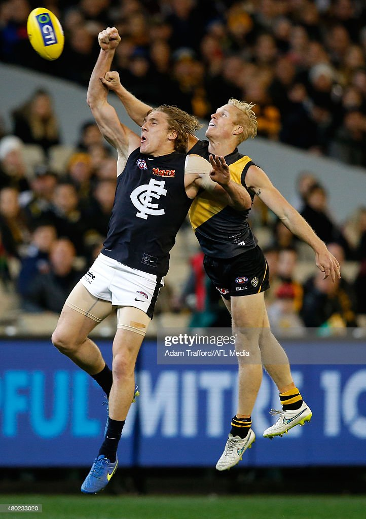 Tom Bell of the Blues and Steven Morris of the Tigers compete for the ball during the 2015 AFL round 15 match between the Richmond Tigers and the Carlton Blues at the Melbourne Cricket Ground, Melbourne, Australia on July 10, 2015.