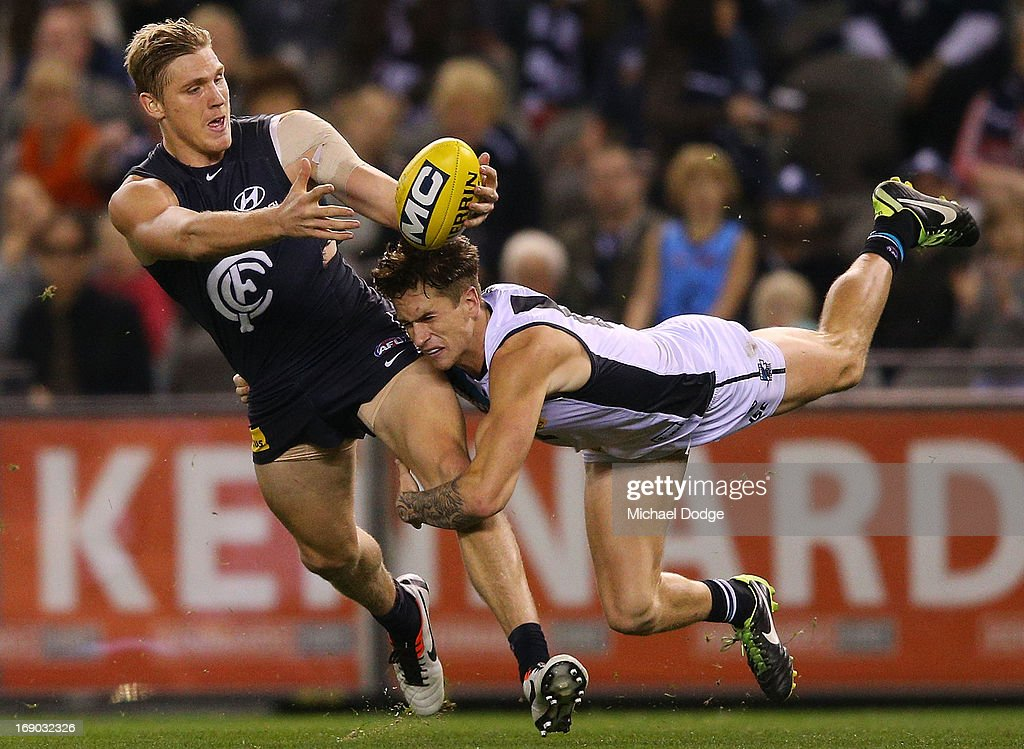 Tom Bell of the Blues gets tackled by Cameron O'Shea of Port Adelaide during the round eight AFL match between the Carlton Blues and Port Adelaide Power at Etihad Stadium on May 19, 2013 in Melbourne, Australia.