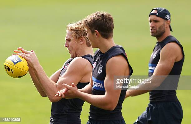 Tom Bell of the Blues marks the ball during a Carlton Blues AFL training session at Ikon Park on April 1 2015 in Melbourne Australia