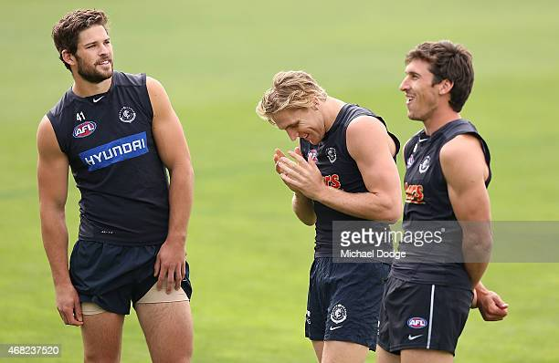 Tom Bell of the Blues reacts with Levi Casboult and Michael Jamison during a Carlton Blues AFL training session at Ikon Park on April 1 2015 in...