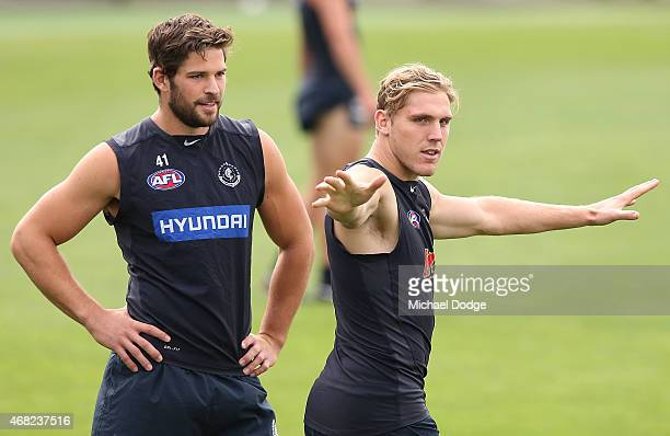 Tom Bell of the Blues reacts with Levi Casboult during a Carlton Blues AFL training session at Ikon Park on April 1 2015 in Melbourne Australia