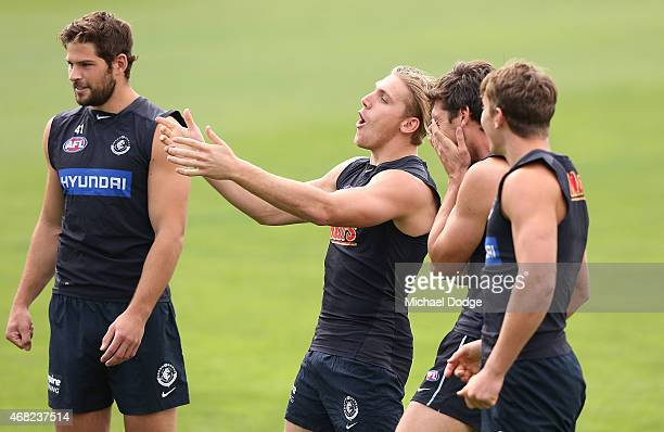 Tom Bell of the Blues reacts with teamates during a Carlton Blues AFL training session at Ikon Park on April 1 2015 in Melbourne Australia