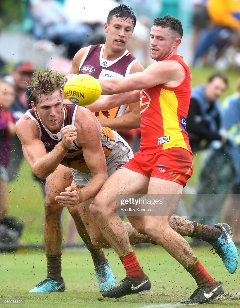 Tom Bell of the Lions gets a handball away during the JLT Community Series AFL match between the Gold Coast Suns and the Brisbane Lions at Fankhauser Reserve on March 11, 2018 in Brisbane, Australia.
