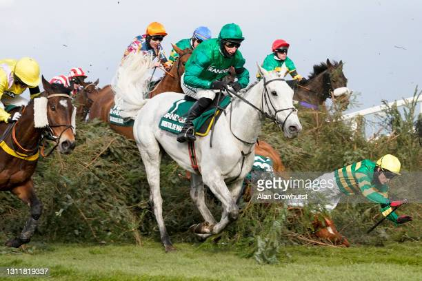Tom Bellamy riding Canelo part company at 'The Chair' during The Randox Grand National Handicap Chase at Aintree Racecourse on April 10, 2021 in...