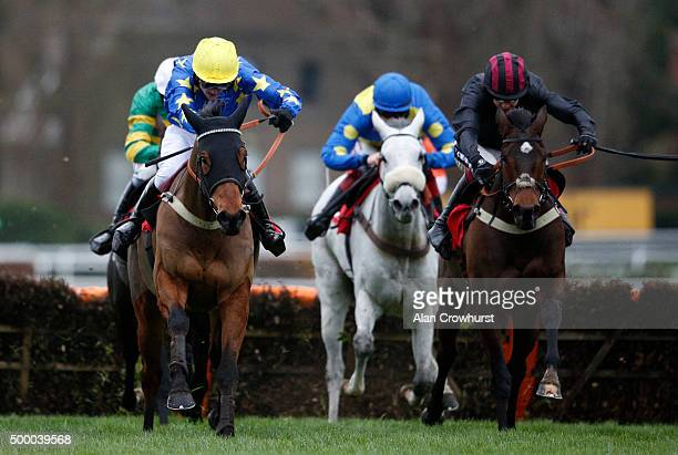 Tom Bellamy riding Simply A Legend clear the last to win The Pertemps Network Handicap Hurdle Race at Sandown racecourse on December 05 2015 in Esher...