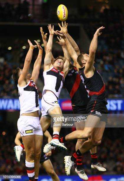 Tom Bellchambers of the Bombers and Jack Billings of the Saints compete for the ball during the round 21 AFL match between the Essendon Bombers and...