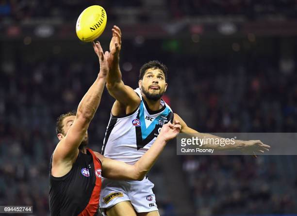 Tom Bellchambers of the Bombers and Patrick Ryder of the Power compete in the ruck during the round 12 AFL match between the Essendon Bombers and the...