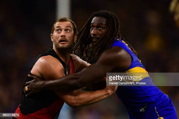 Tom Bellchambers of the Bombers contests a boundary throw in against Nic Naitanui of the Eagles during the 2018 AFL round 14 match between the West...
