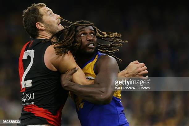 Tom Bellchambers of the Bombers contests a ruck with Nic Naitanui of the Eagles during the round 14 AFL match between the West Coast Eagles and the...