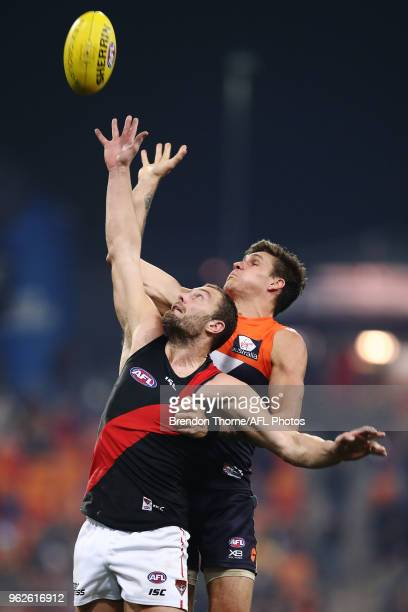 Tom Bellchambers of the Bombers contests the ball with Rory Lobb of the Giants during the round 10 AFL match between the Greater Western Sydney...