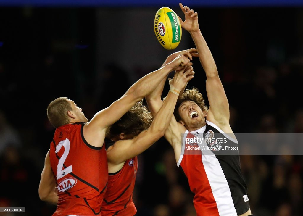 Tom Bellchambers of the Bombers, Joe Daniher of the Bombers and Tom Hickey of the Saints compete for the ball during the 2017 AFL round 17 match between the St Kilda Saints and the Essendon Bombers at Etihad Stadium on July 14, 2017 in Melbourne, Australia.