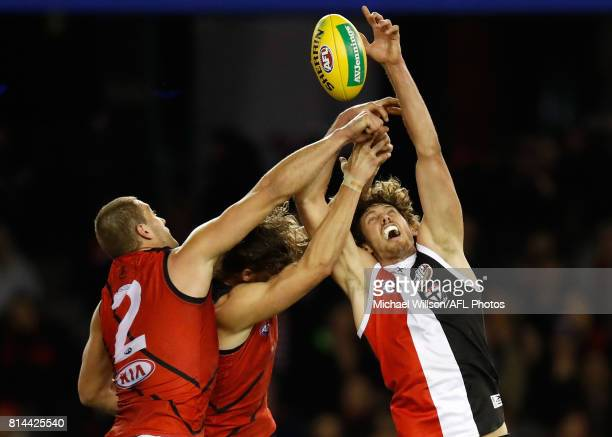 Tom Bellchambers of the Bombers Joe Daniher of the Bombers and Tom Hickey of the Saints compete for the ball during the 2017 AFL round 17 match...