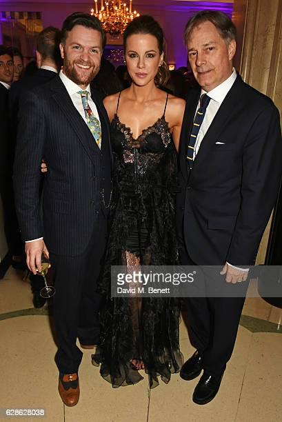 Tom Bennett Kate Beckinsale and Whit Stillman arrive at The London Evening Standard British Film Awards at Claridge's Hotel on December 8 2016 in...
