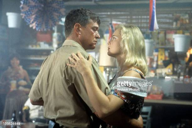 Tom Berenger and Erika Eleniak dancing in a scene from the film 'Chasers' 1994