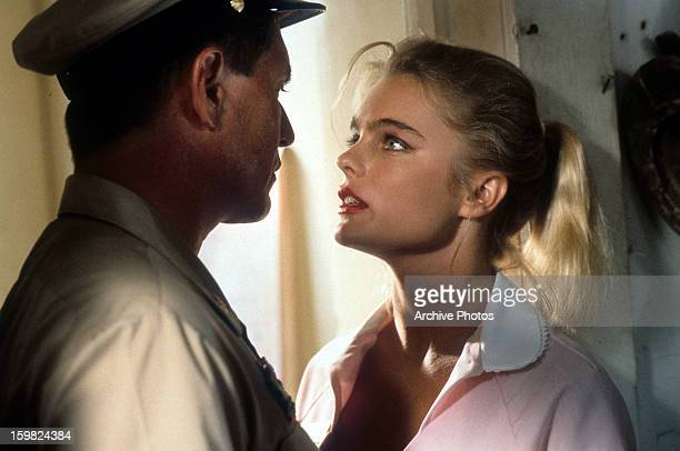 Tom Berenger and Erika Eleniak looking into each other's eyes in a scene from the film 'Chasers' 1994