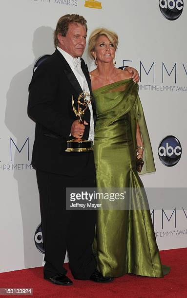 Tom Berenger and Laura Moretti pose in the press room at the 64th Primetime Emmy Awards held at Nokia Theatre LA Live on September 23 2012 in Los...