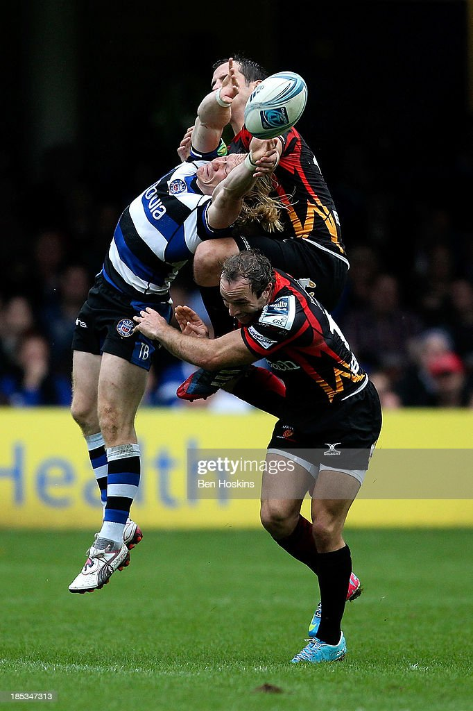 Tom Biggs of Bath goes up for a high ball against Will Harries of Newport during the Amlin Challenge Cup match between Bath and Newport Gwent Dragons at Recreation Ground on October 19, 2013 in Bath, England.