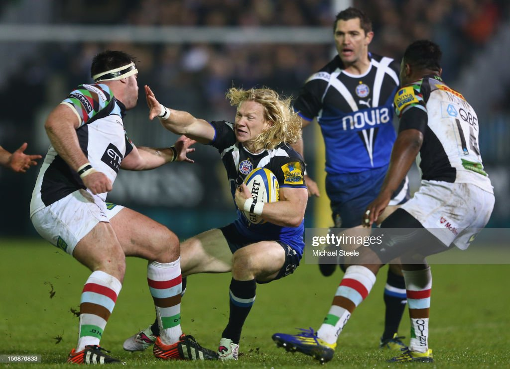 Tom Biggs (C) of Bath holds off Will Collier (L) of Harlequins during the Aviva Premiership match between Bath and Harlequins at the Recreation Ground on November 23, 2012 in Bath, England.