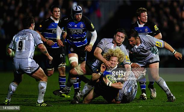 Tom Biggs of Bath is tackled by Calum Green of Leicester Tigers during the LV=Cup Semi Fianal match between Bath and Leicester Tigers at Recreation...