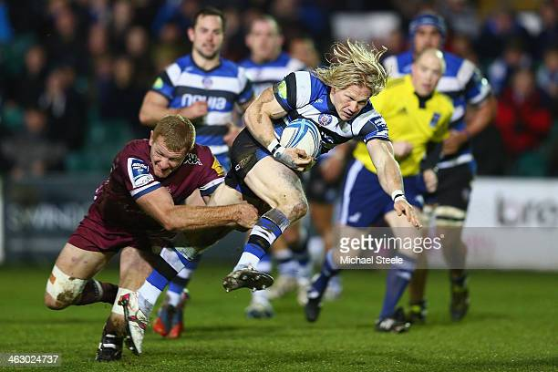 Tom Biggs of Bath rides a challenge from Cameron Treloar of Bordeaux Begles during the Amlin Challenge Cup match between Bath and Bordeaux Begles at...