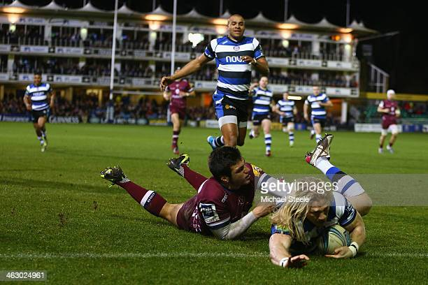 Tom Biggs of Bath scores his sides opening try despite the challenge from Joaquim Tuculet of Bordeaux Begles during the Amlin Challenge Cup match...