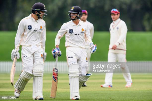Tom Blundell and Peter Younghusband of Wellington walk from the ground at the end of the second day during the Plunket Shield match between...