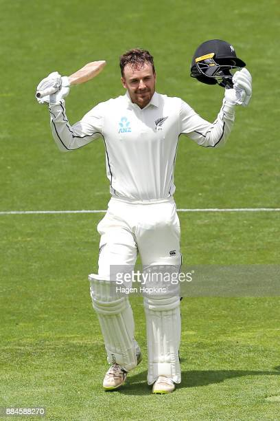 Tom Blundell of New Zealand celebrates after reaching his maiden test century on debut during day three of the Test match series between New Zealand...