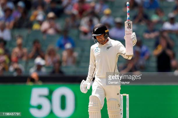 Tom Blundell of New Zealand raises his bat after scoring 50 runs during day four of the Second Test match in the series between Australia and New...