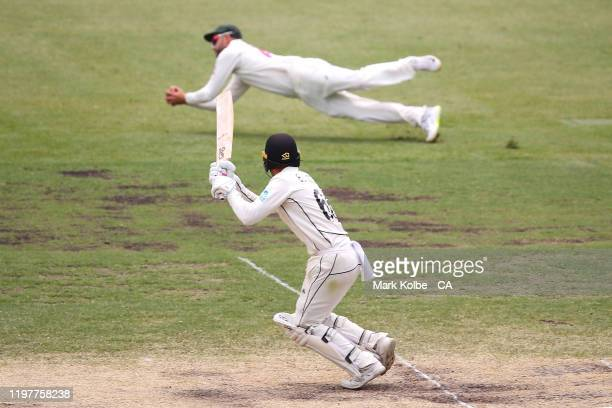 Tom Blundell of New Zealand watches on as he is caught by Nathan Lyon of Australia during day four of the Third Test Match in the series between...