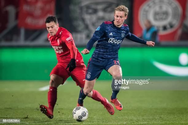 Tom Boere of FC Twente Frenkie de Jong of Ajax during the Dutch Eredivisie match between FC Twente Enschede and Ajax Amsterdam at the Grolsch Veste...