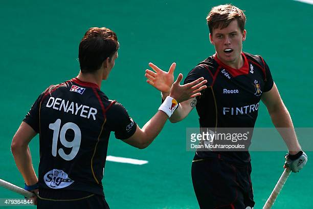 Tom Boon of Belgium is congratulated by team mate Felix Denayer after he scores a goal during the Fintro Hockey World League SemiFinal match between...