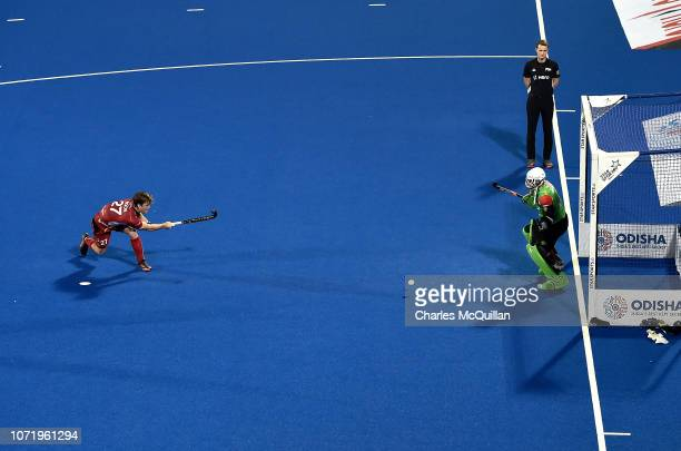 Tom Boon of Belgium scores his sides fifth goal during the FIH Men's Hockey World Cup Crossover match between Belgium and Pakistan at Kalinga Stadium...