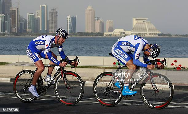 Tom Boonen and Sebastien Rosseler of the Belgian cycling team Quick Step compete in the first stage of the 2009 Tour of Qatar cycling race, a six...