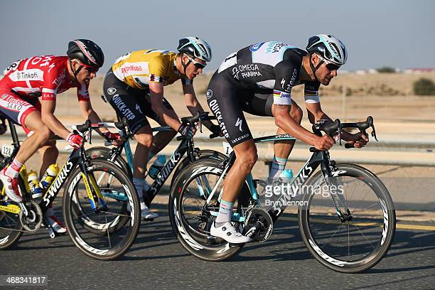 Tom Boonen of Belgium and Omega Pharma Quick Step rides at the front of the race during stage two of the Tour of Qatar from Camel Race Track to Al...