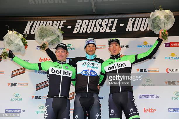 Tom Boonen of Belgium and Omega PharmaQuickStep Cycling Team celebrates victory on the podium alongside second placed Moreno Hofland and Sep...