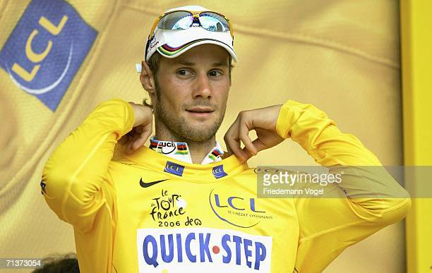 Tom Boonen of Belgium and Quick Step celebrates his yellow jersey as overall leader on the podium after Stage Four of the 93rd Tour de France between...