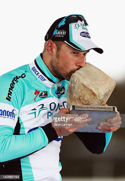 Tom Boonen of Belgium and Quick Step Omega Pharma celebrates winning the 2012 Paris Roubaix cycle race from Compiegne to Roubaix on April 8, 2012 in...