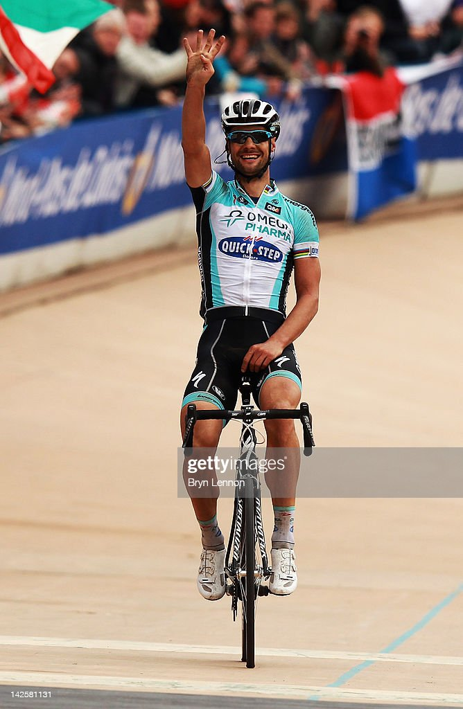 Tom Boonen of Belgium and Quick Step Omega Pharma crosses the finishline to win the 2012 Paris Roubaix cycle race from Compiegne to Roubaix on April 8, 2012 in Paris, France. The 110th edition of the race is 257km long with 51.5km of cobbles spread over 27 sections.