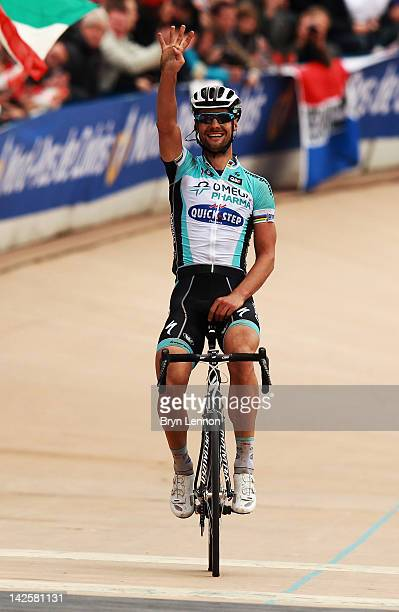 Tom Boonen of Belgium and Quick Step Omega Pharma crosses the finishline to win the 2012 Paris Roubaix cycle race from Compiegne to Roubaix on April...