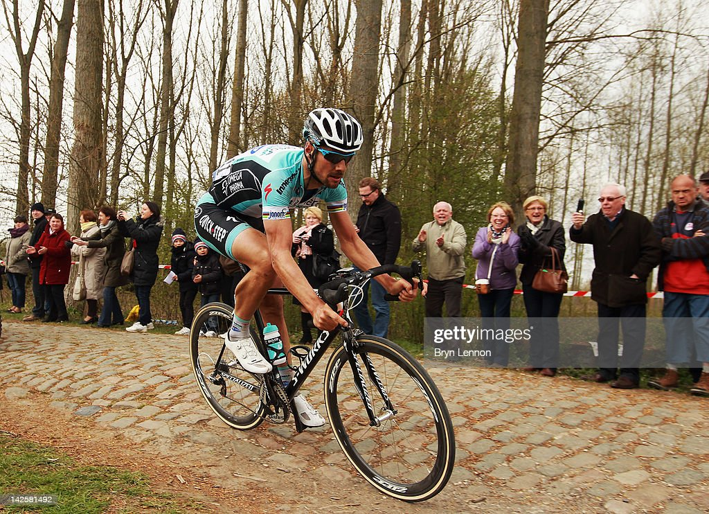 Tom Boonen of Belgium and Quick Step Omega Pharma rides over the cobbles on his way to winning the 2012 Paris Roubaix cycle race from Compiegne to Roubaix on April 8, 2012 in Paris, France. The 110th edition of the race is 257km long with 51.5km of cobbles spread over 27 sections.