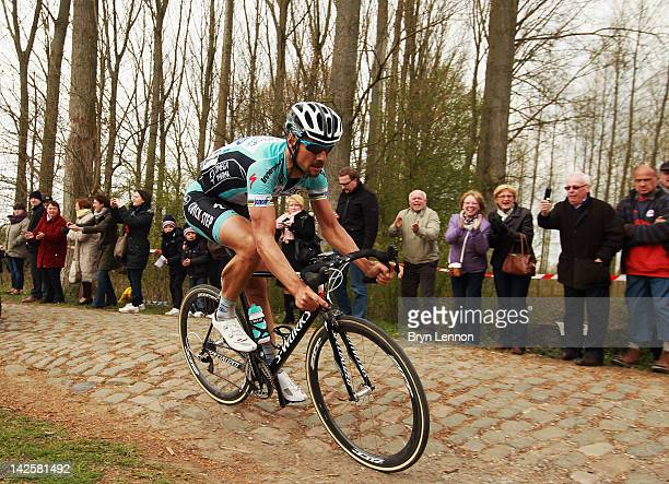 Tom Boonen of Belgium and Quick Step Omega Pharma rides over the cobbles on his way to winning the 2012 Paris Roubaix cycle race from Compiegne to...