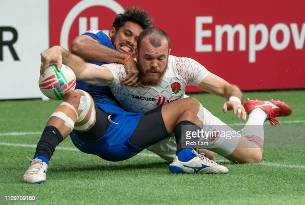 Tom Bowen of England reaches for the try line while being tackled by Elisapeta Alofipo of Samoa during rugby sevens action on Day 2 of the HSBC...