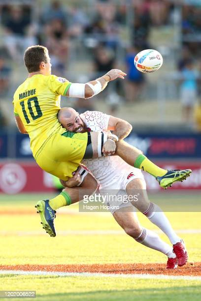 Tom Bowen of England tackles Nick Malouf of Australia during the bronze match between Australia and England at the 2020 HSBC Sevens at FMG Stadium...