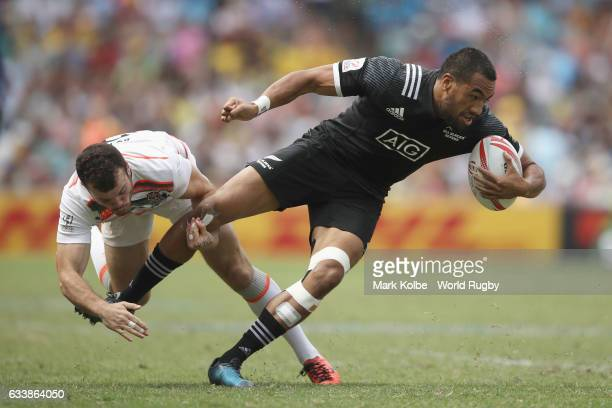 Tom Bowen of England tackles Sione Molia of New Zealand during the semi final match between England and New Zealand in the 2017 HSBC Sydney Sevens at...