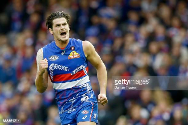 Tom Boyd of the Bulldogs celebrates a goal during the round 10 AFL match between the Western Bulldogs and the St Kilda Saints at Etihad Stadium on...