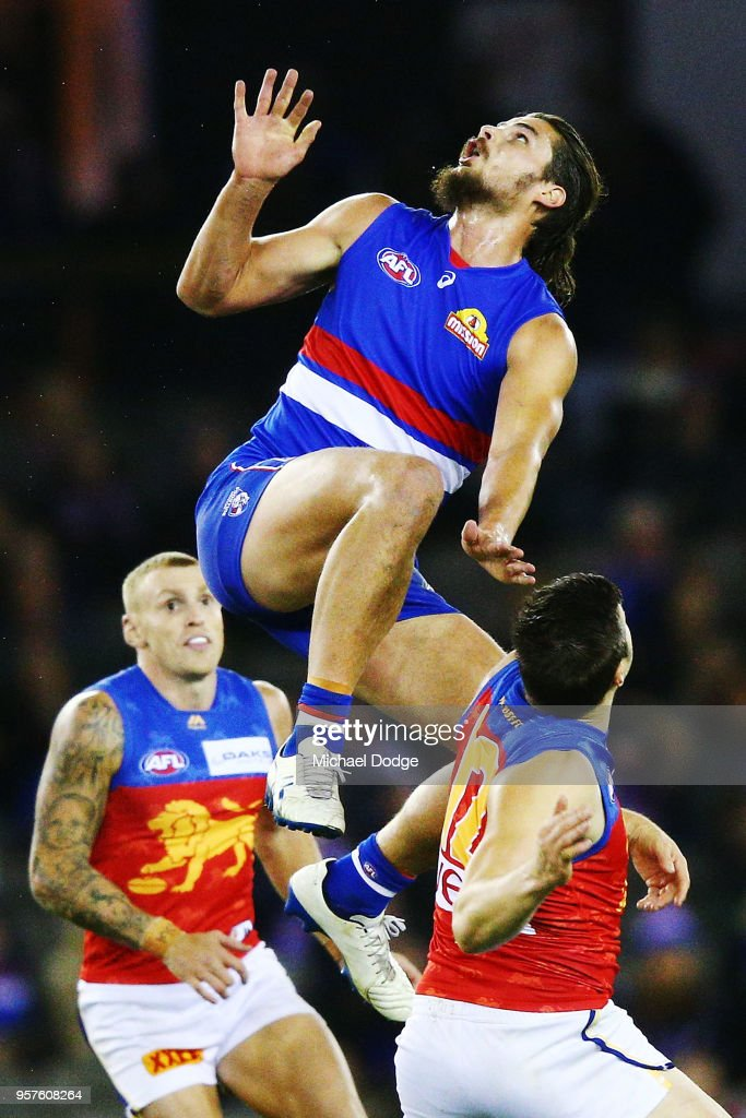 Tom Boyd of the Bulldogs competes for the ball over Stefan Martin of the Lions during the round eight AFL match between the Western Bulldogs and the Brisbane Lions at Etihad Stadium on May 12, 2018 in Melbourne, Australia.